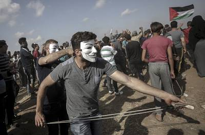 Palestinian protesters during clashes near the fence separating the Gaza Strip from Israel on Friday.
