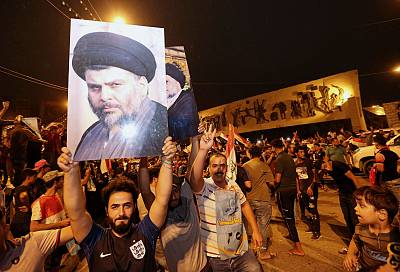 Supporters of Shiite cleric Muqtada al-Sadr celebrate in Baghdad, Iraq, on Monday.