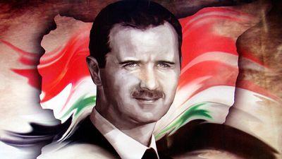 """""""Apoiem Assad"""": Uma t-shirt russa com pano para mangas"""