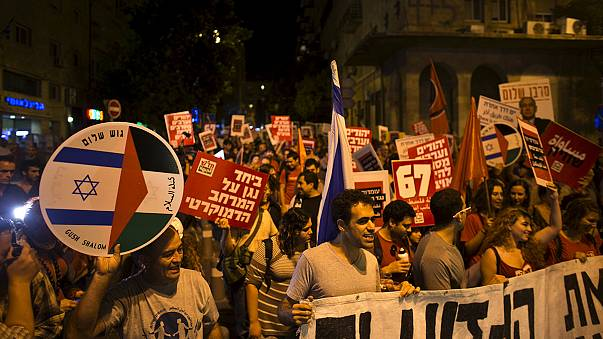 Peace replaces bloodshed as hundreds march through Jerusalem
