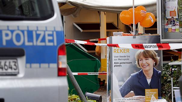 Germans rally to support mayoral candidate stabbed in 'anti-refugee attack'