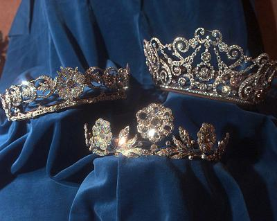 The flowers on the Strathmore Rose tiara (at bottom) can be removed and used as individual brooches.
