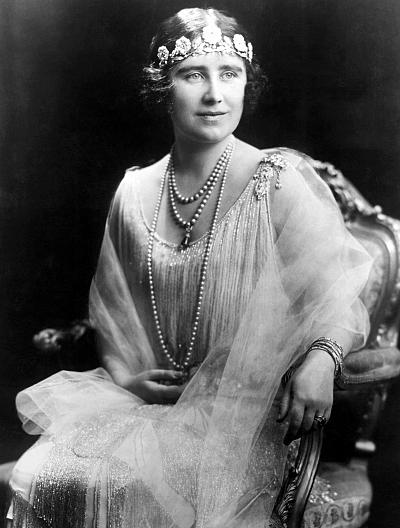 The Queen Mother wore the Strathmore Rose tiara low around forehead in true '20s flapper style.