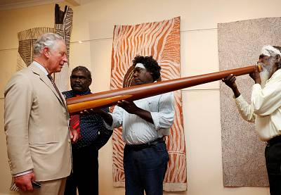 The Prince of Wales takes part in a didgeridoo demonstration during a visit to Australia last month.