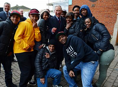 Prince Charles with young participants in the Prince\'s Trust activities.