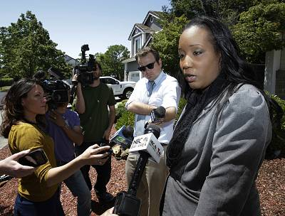 Ina Rogers talks with reporters about the seizure of her 10 children on Monday in Fairfield, California.