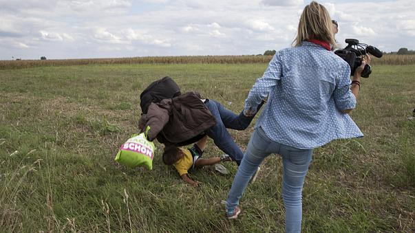 Hungarian camerawoman vilified for tripping a migrant, plans to sue