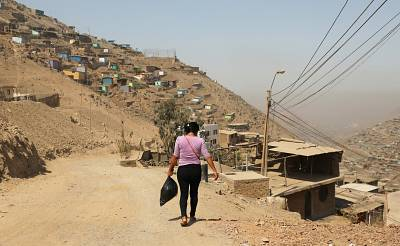 A woman walks in the area of Nueva Esperanza, in the outskirts of Lima, Peru.