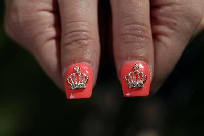 Christine Deaver shows off her nails encrusted with crowns.