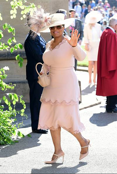 Oprah Winfrey wears the new dress Stella McCartney\'s team created for her the night before the wedding of Meghan Markle and Prince Harry.