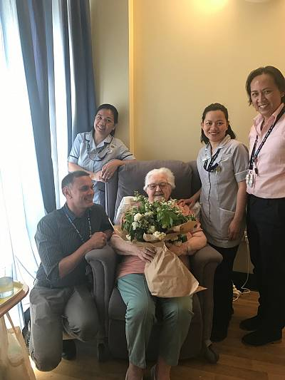 Pauline Clayton, a patient at St. Joseph\'s, holds a bouquet of flowers from the royal wedding.