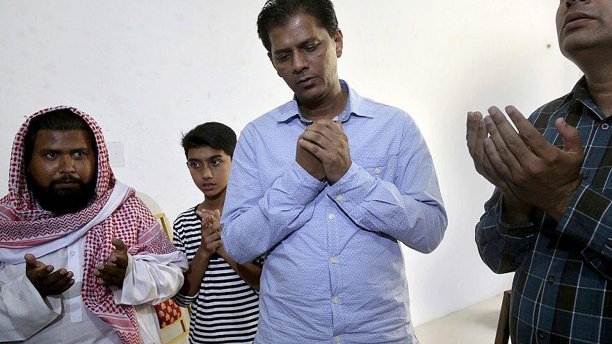 Image: Abdul Aziz Sheikh, center, father of Sabika Sheikh
