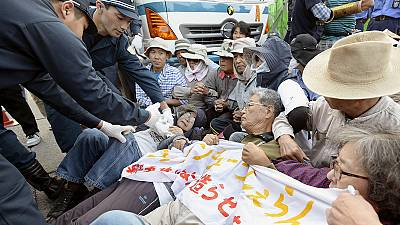 Protesters clash with police over planned US airbase in Japan