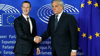 Image: Facebook's CEO Mark Zuckerberg shakes hands with European Parliament
