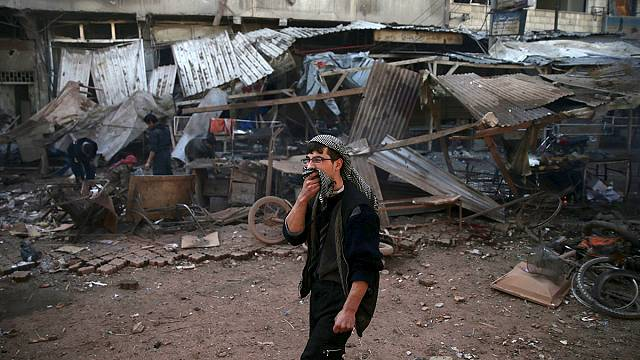 Syrian 'government missiles' kill dozens in Syrian market town