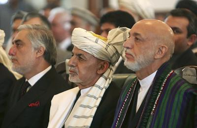 Afghan President Ashraf Ghani, center, former President Hamid Karzai, right, and Chief Executive Abdullah Abdullah, left, at the presidential palace in Kabul, Afghanistan on Sept. 29, 2016.