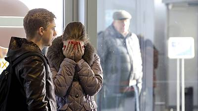 Anxious relatives await news of loved ones at St Petersburg Airport