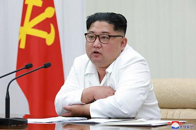North Korean leader Kim Jong Un speaks during a meeting of the 7th central military commission at an undisclosed place in North Korea in an image released on May 18, 2018.
