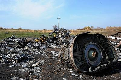 The wreckage of Malaysia Airlines flight MH17 remains scattered near the village of Rassipnoe, Ukraine, on Oct. 15, 2014.