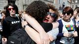 Image: Two women embrace as they wait for the official result of the Aborti