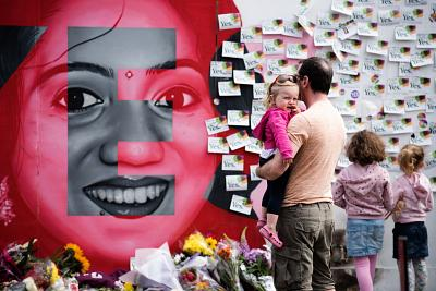 Floral tributes are laid at a mural to Savita Halappanavar, a 31-year-old Indian dentist, who died in 2012 due to the complications of a septic miscarriage at 17 weeks\' gestation.