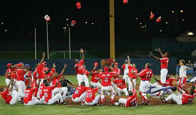 Cuba celebrates its 6-2 win over Australia in the gold-medal game during the Athens 2004 Olympic Games.