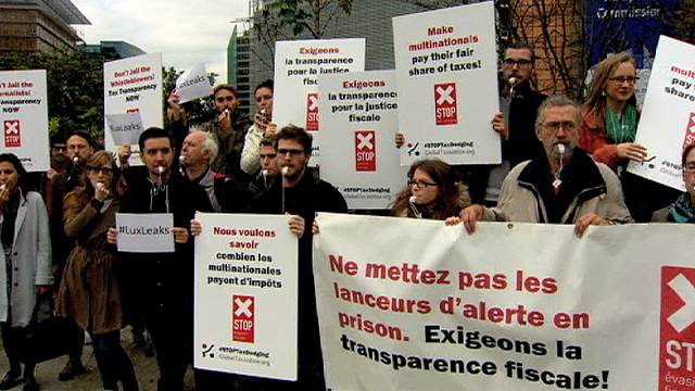 Protesters blow whistles in Brussels to draw attention to the plight of whistleblowers and press freedom one year after Lux leaks