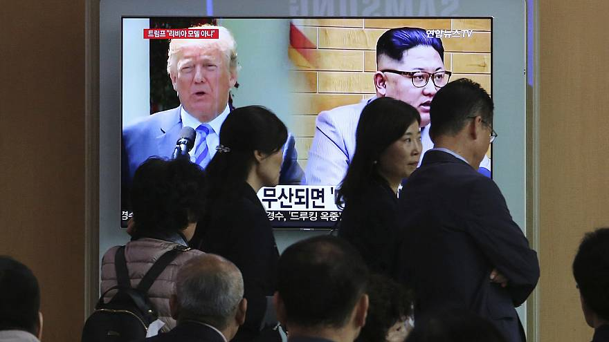 Image: President Donald Trump and North Korean leader Kim Jong Un appear on