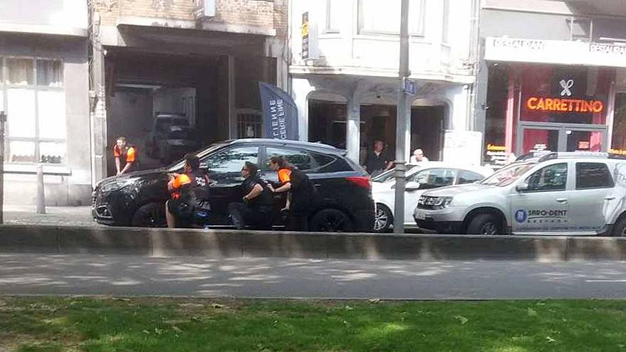 Image: Police officers are seen on the scene of a shooting in Liege