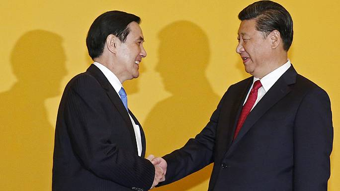 Political foes Taiwan and China hold historic talks