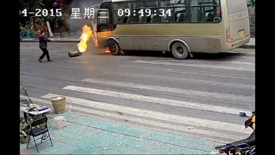 Rolling gas cylinder causes bus fire in southwest China