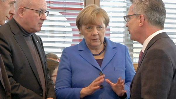Refugiados dividem governo alemão