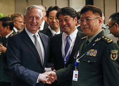 Mattis takes hard line on China in Singapore speech
