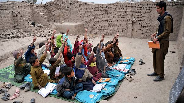 Image: Afghan school children study at an open classroom in the outskirts o