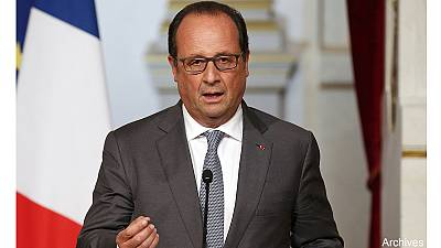 Paris attacks: François Hollande calls for unity and calm