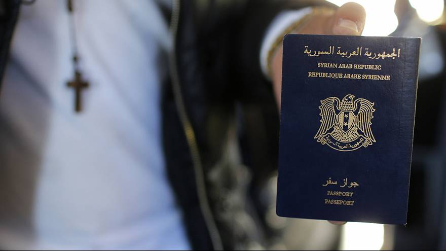 Questions asked over Syrian passport found by body of a Paris suicide bomber