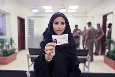 Esraa Albuti she displays her new driving license in Riyadh, Saudi Arabia, on Monday.