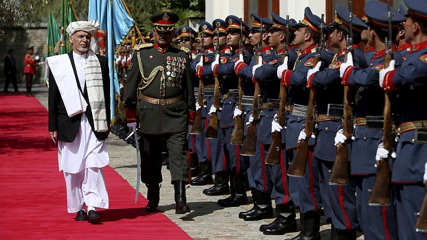 Image: Afghan President Ashraf Ghani inspects an honor guard at the preside