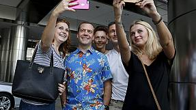 Getting shirty: Medvedev poses for selfies