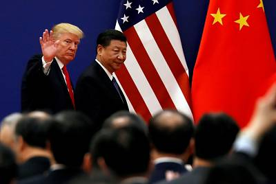 President Donald Trump and China\'s President Xi Jinping meet business leaders at the Great Hall of the People in Beijing on Nov. 9.