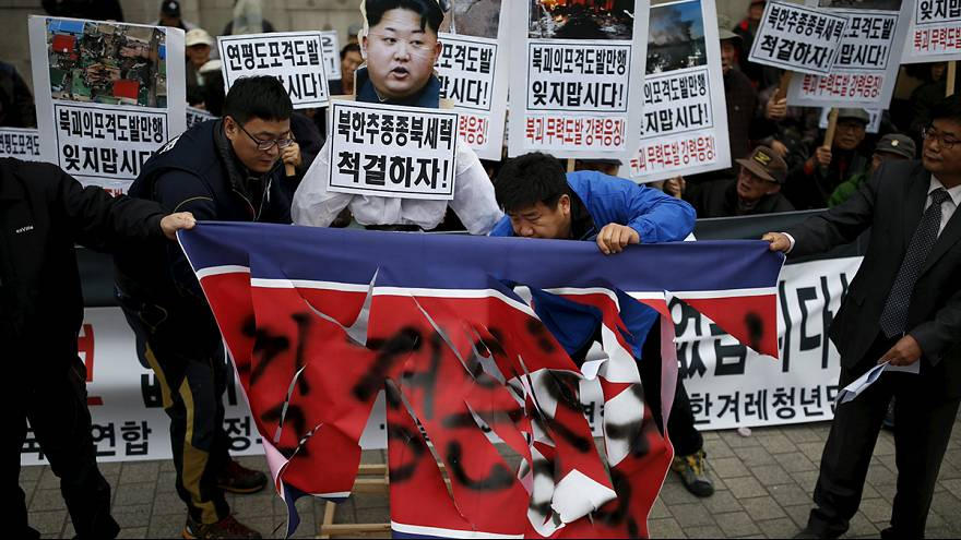 North Korea protesters beat effigy of Kim Yong-un