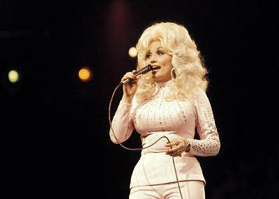 Dolly Parton performing live onstage at the UK Country Music Festival in 1976.