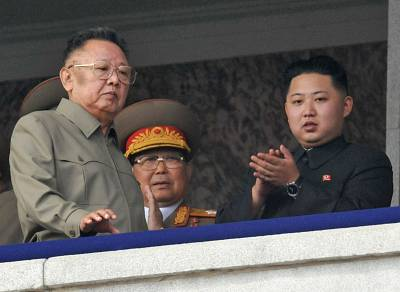 Kim Jong Il (left) with youngest son Kim Jong Un (right) as they watch a parade in Pyongyang, North Korea, in 2010.