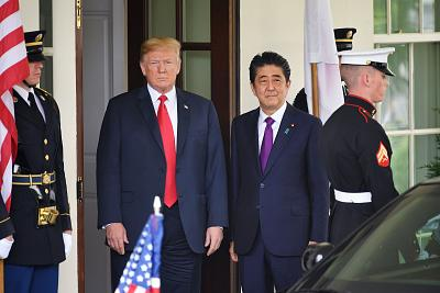 President Donald Trump greets Japan\'s Prime Minister Shinzo Abe upon his arrival at the White House for meetings on June 7, 2018 in Washington, DC.