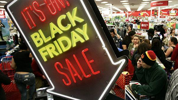 Black Friday in America: crowds in stores thin, but big at computers