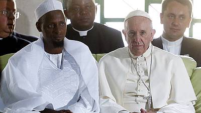 Pope Francis concludes Africa visit with prayers at Bangui mosque and open-air Mass