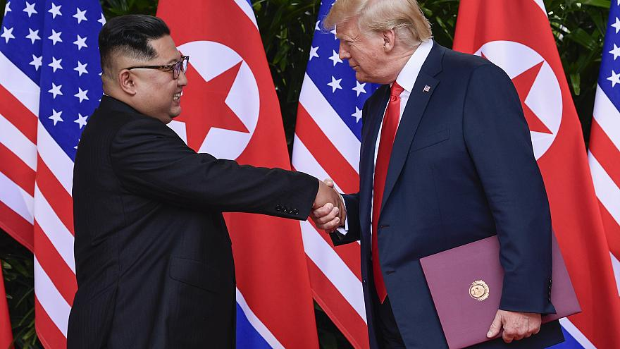 Image: North Korea leader Kim Jong Un and U.S. President Donald Trump shake