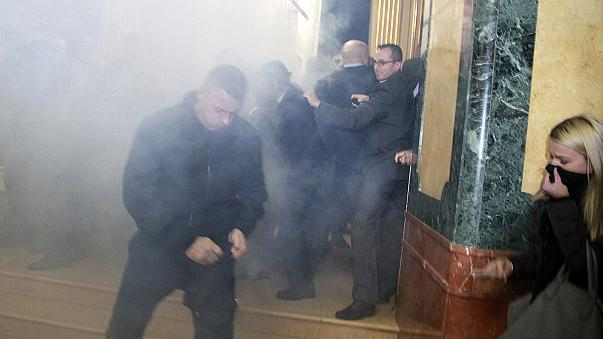 Tear gas protest hits Kosovo parliament ahead of Kerry visit