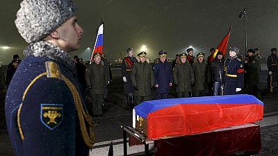 Body of Russian bomber pilot Oleg Peshkov arrives in Moscow