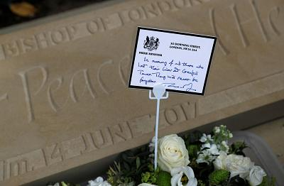 A signed message from Prime Minister Theresa May was left at church near Grenfell Tower.